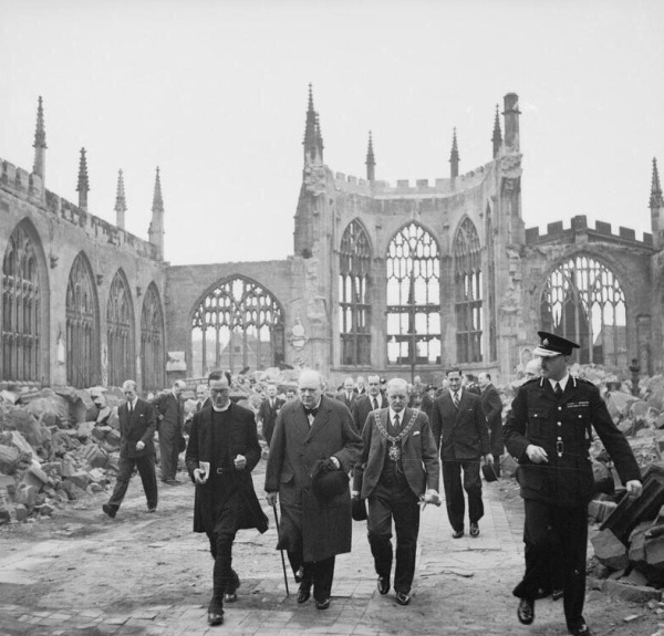 Winston Churchill inspects the ruins of the Coventry Cathedral following the 14 November 1940 blitz conducted by the Luftwaffe.