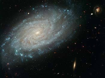 Intricate spiral arms contain areas of new star formation in this dusty galaxy. This galaxy, which lies about 100 million light-years away, toward the direction of the constellation Leo, was home to a supernova that appeared in 1994.